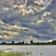 Cloudscape above river — Stock Photo