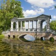 Old bridge above pond — Stock Photo