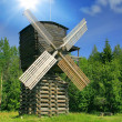 Windmill in forest under sun — Stock Photo #6415477