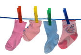 Clothes-pegs and socks — Stock Photo