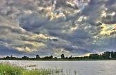 Cloudscape above river — Stock Photo