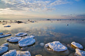 Sky reflection in winter sea — Stock Photo