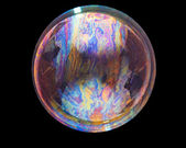 Soap bubble on black — Stock Photo