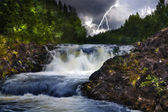 Waterfall with lightning — Stock Photo