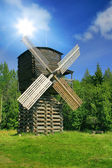 Windmill in forest under sun — Stock Photo
