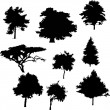 Nine tree silhouettes — Stock Vector