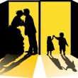 Couple and children silhouettes in doorway — Stock Vector