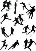 Soccer player silhouettes — Stock Vector