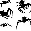 Five spider silhouettes on white — Stock Vector