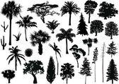 Large set of black trees on white — Stock Vector