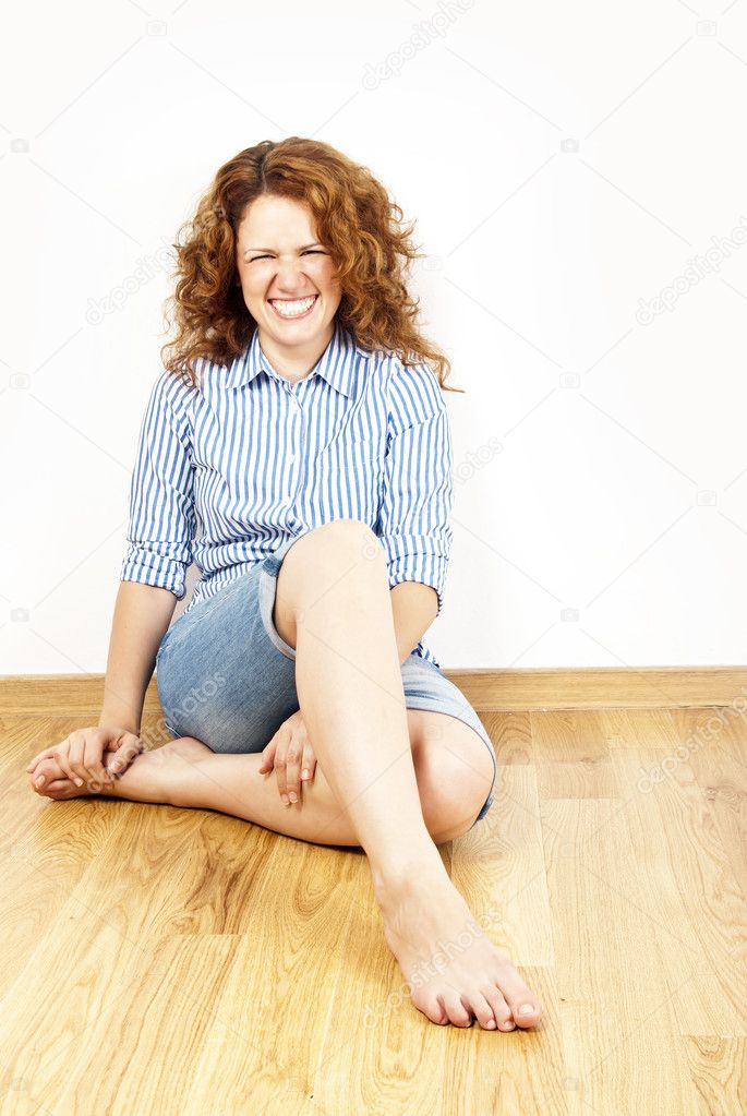 Young woman with red hair on the floor — Stock Photo #6477326