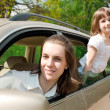 Stock Photo: Family traveling by car