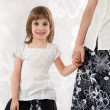 Stock Photo: Mother and daughter - holding hands