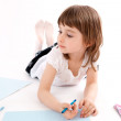 Little girl draws a picture. — Stock Photo #6309013