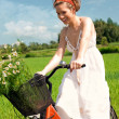 Happy woman on cycle ride in countryside — Stock Photo