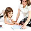 Stock Photo: Mom and daughter crayon on paper