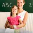 Teacher and schoolchild — Stock Photo