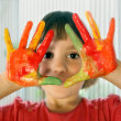 Schoolgirl with painted hands — Stock Photo
