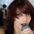 Beautiful rock singer with microphone — Stock fotografie #6309415