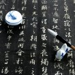 Stock Photo: Chinese calligraphy on black