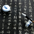 Chinese calligraphy on black — Stock Photo