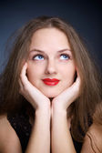Portrait of beautiful young woman with big eyes — Stockfoto