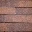 Brown asphalt roofing shingles. - Stock Photo