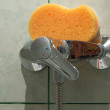 Stock Photo: Faucet and sponge