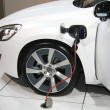 White hybrid car on recharge — Foto de stock #5481993