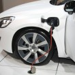 Foto Stock: White hybrid car on recharge
