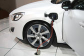 White hybrid car on recharge — 图库照片