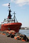 Orange fishing trawler in the harbour — Stock Photo