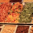 Nuts and dried fruits on a market - Foto de Stock  