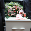 Royalty-Free Stock Photo: White coffin in a grey hearse