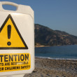 Warning on beach - Stock Photo