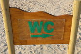 WC sign on the beach — Stock Photo
