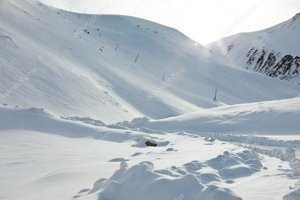 Snow mountains, sun beams, it is a lot of snow — Stock Photo #6245770