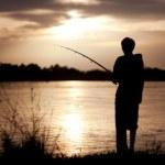The fisherman at sunset — Stock Photo