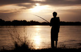 The fisherman at sunset — Stock Photo