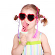 Little girl with watermelon ice cream and sunglasses — Stock Photo #5413240