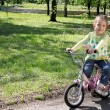 Child riding bicycle — Stock Photo #5498663