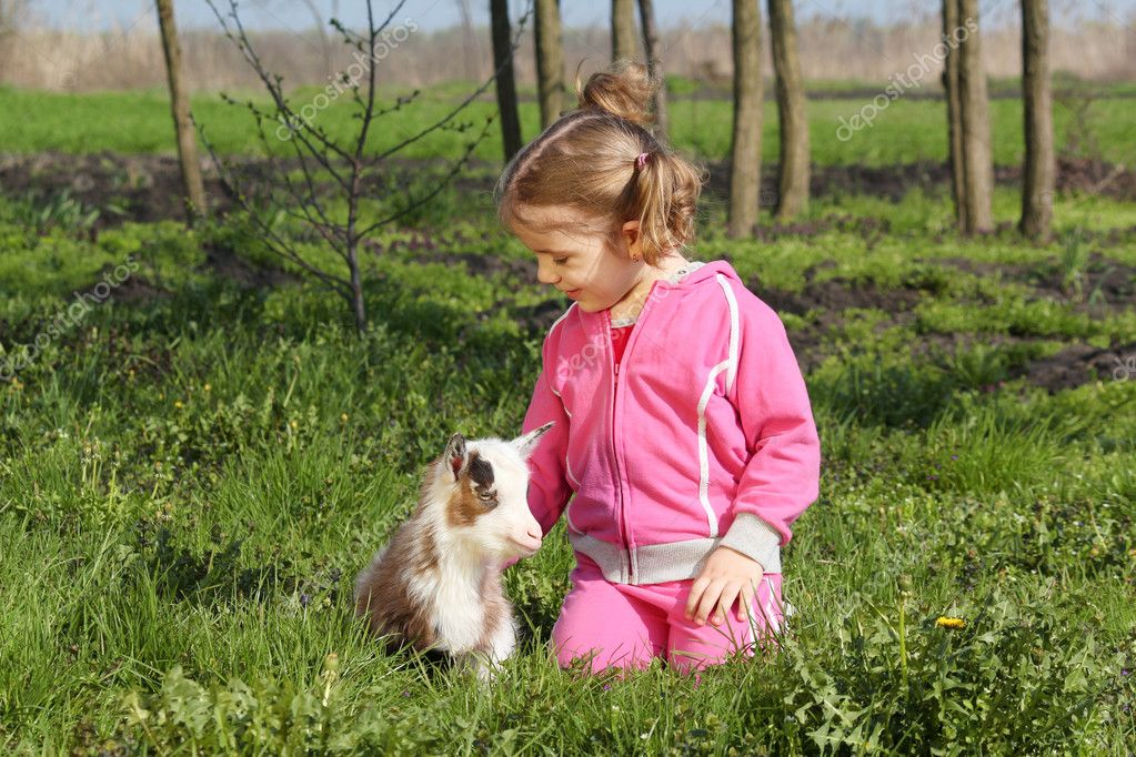 Little girl with kid pet  Stock Photo #5499373