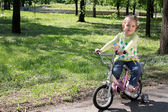 Child riding bicycle — Stock Photo