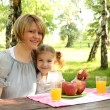 Mother and daughter picnic — Stock Photo