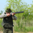 Stock Photo: Hunter aiming with shotgun