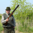 Hunter posing with shotgun — Stockfoto