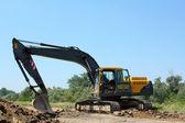 Construction site with excavator — Stock Photo
