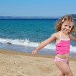 Young girl posing on the beach — Stock Photo #6160701