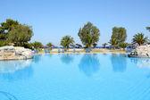 Swimming pool summer vacation scene — Stock Photo