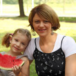 Mother and daughter with watermelon — Stock Photo #6373343
